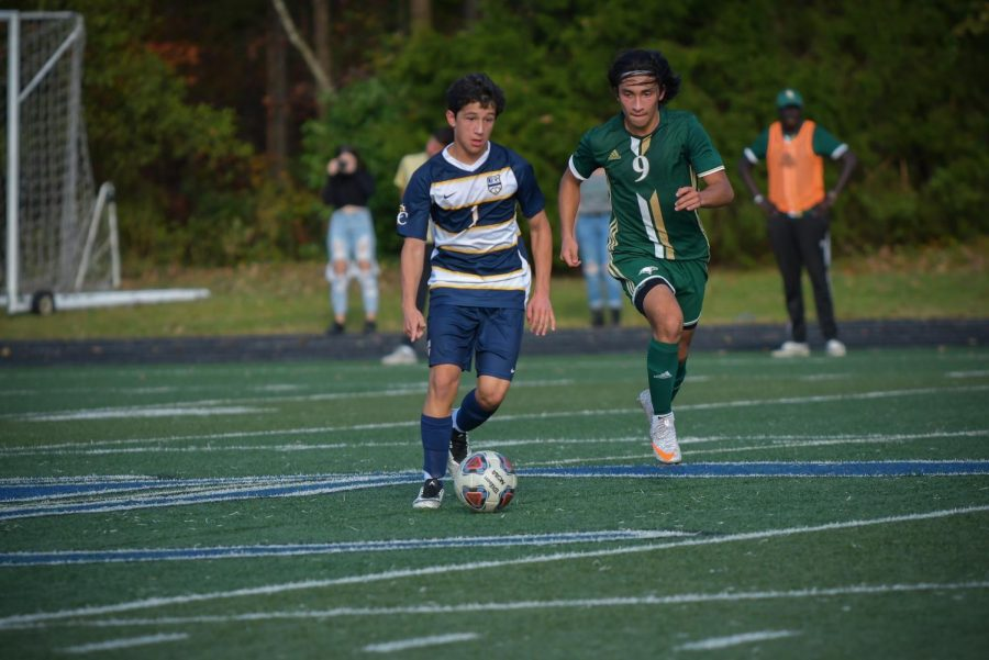 Kevin Perez taking on Rabun Gap player in the state championship game.
