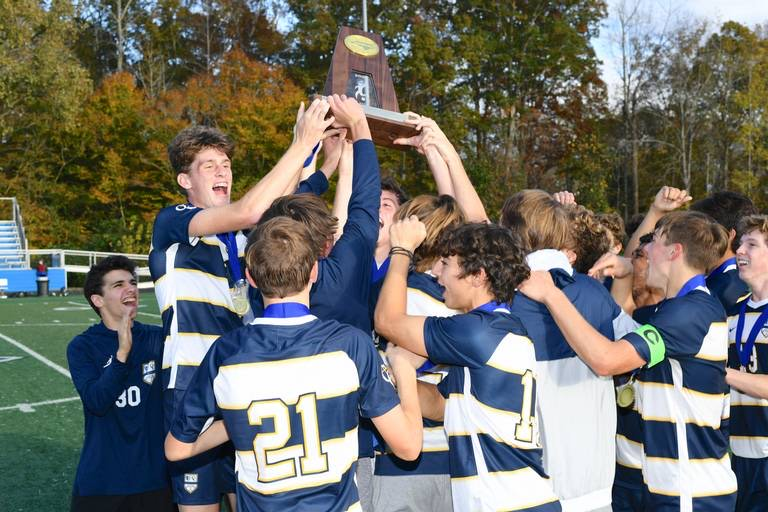After years of preparation and heartbreak, the team finally celebrates with their first state title in the soccer program's history.