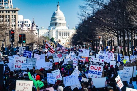 "Citizens gather in downtown Washington D.C., to protest outside of the Capitol Building.  Thousands from across the country gathered for a ""Save America"" rally on January 6, 2021, at the Ellipse where former President Trump rallied his supporters to protest the alleged stolen presidential election."
