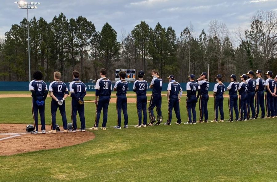 CCS 2021 men's varsity baseball team lines up for one of their first games.  The team has returned back to the field after their season was cut short last year.