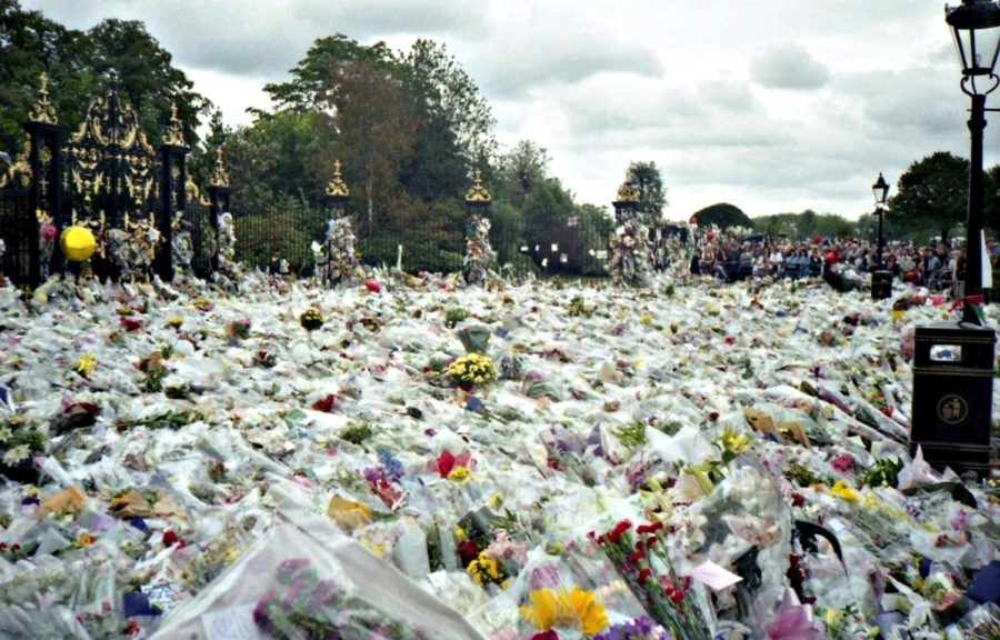 """Buckingham Place overflows with flowers adoring the late Princess Diana. Known as the """"people"""