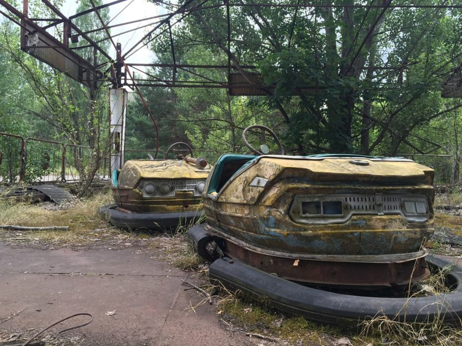 bumper cars in Chernobyl overgrown with vines