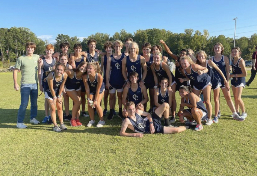 The Varsity Cross Country team gathers for a post meet picture. The Cross Country Team ran against Wesleyan and won the meet.